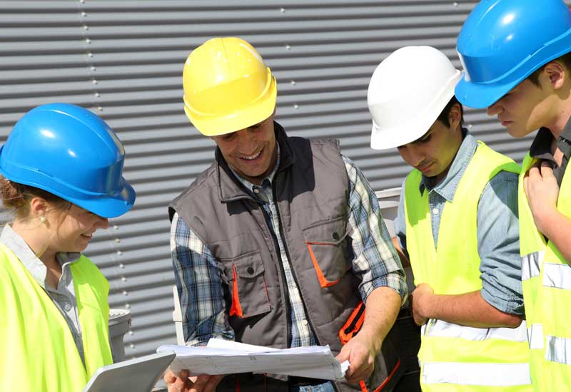 Superior Scaffolding & Insulation, Inc. Image of Construction Workers Looking at Blueprints
