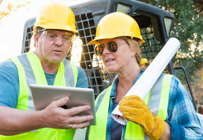 Superior Scaffolding & Insulation, Inc. Image of Construction Workers Looking at iPad