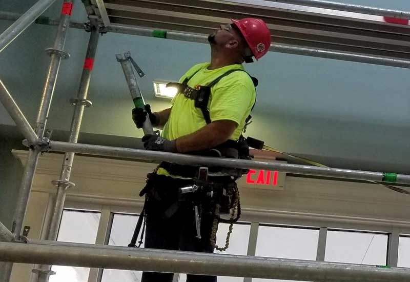 Image of Construction Worker Setting Up Scaffolding