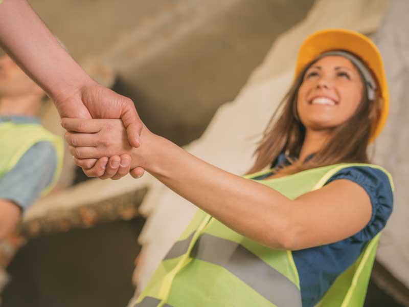 Image of Construction Workers Shaking Hands