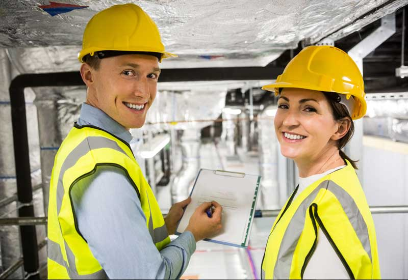 Superior Scaffolding & Insulation, Inc. Image of Construction Workers Smiling with Clipboard