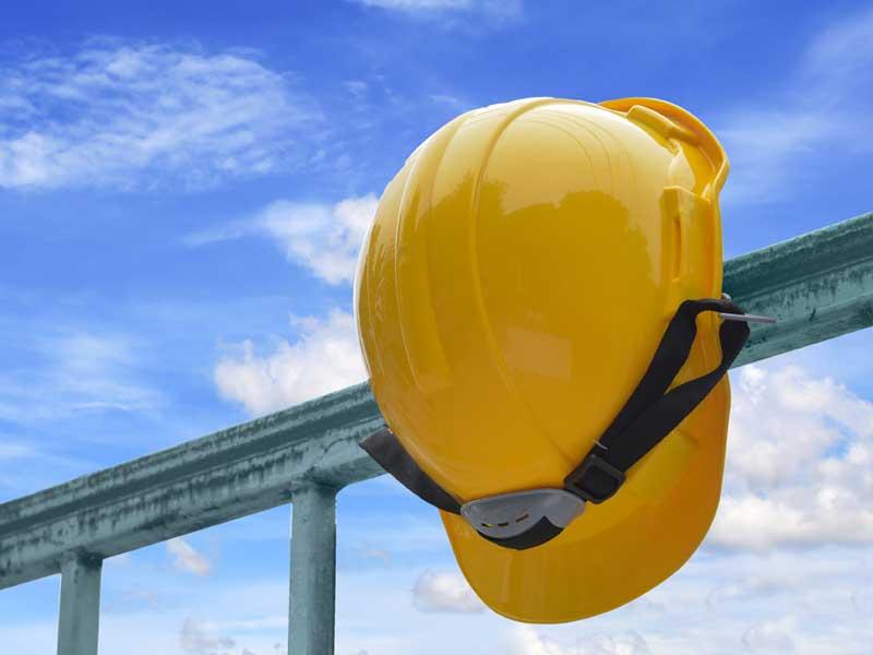 Image of Yellow Hardhat on Railing