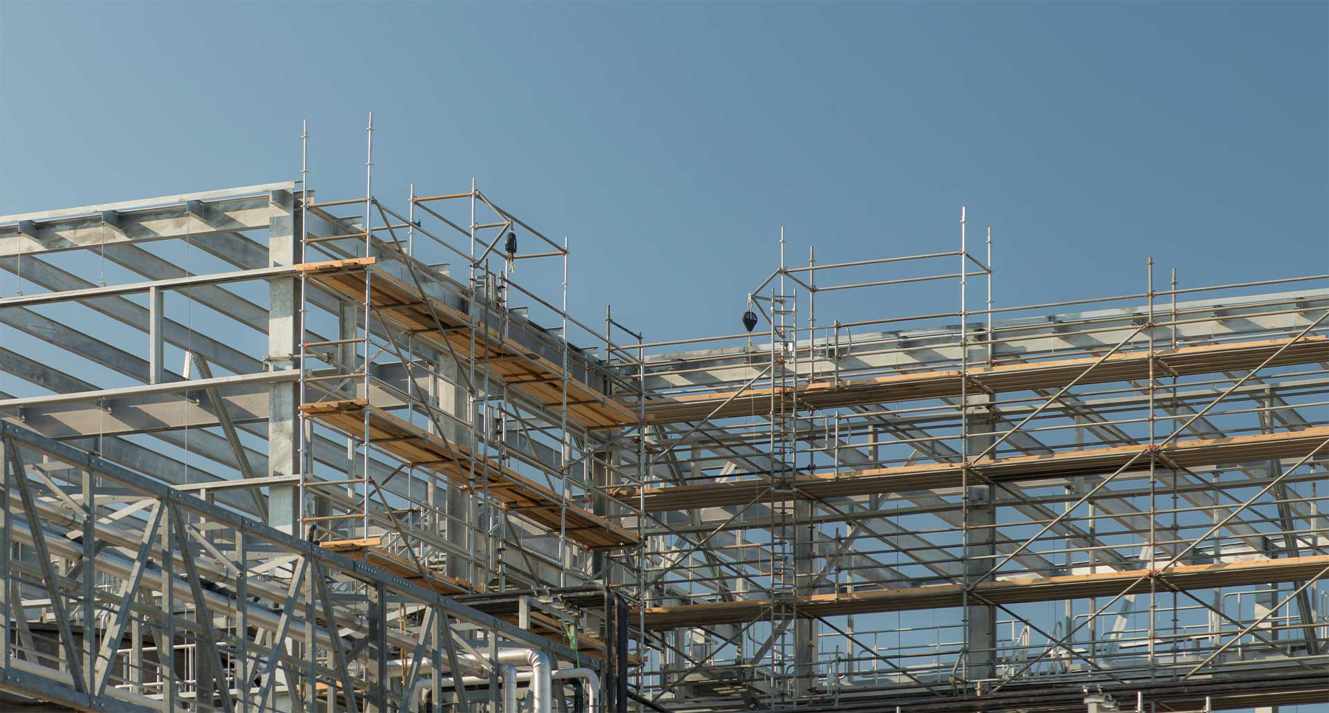 Superior Scaffolding & Insulation, Inc. Image of Construction Site and Scaffolding Slide